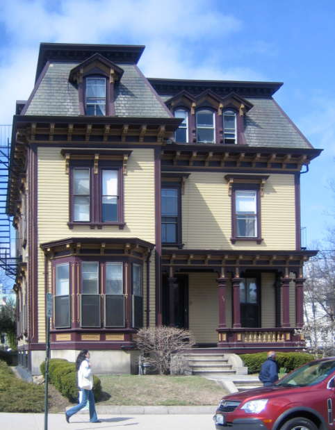 Second empire single family house with mansard roof bay for Mansard architecture