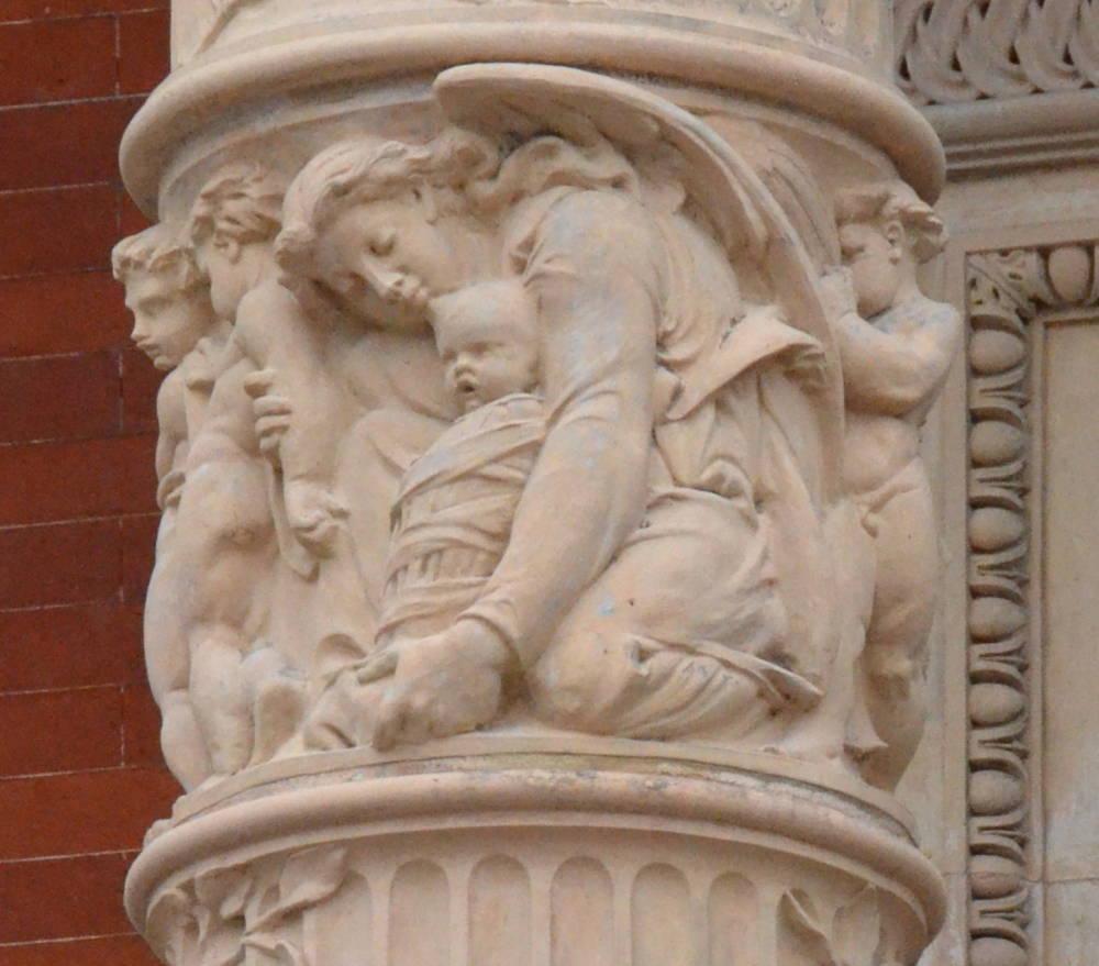 Angel Holding Baby Art Angel holding a swaddled