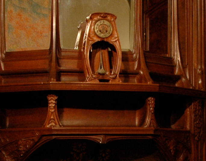 clock and mantelpiece in art nouveau room the wisteria dining room