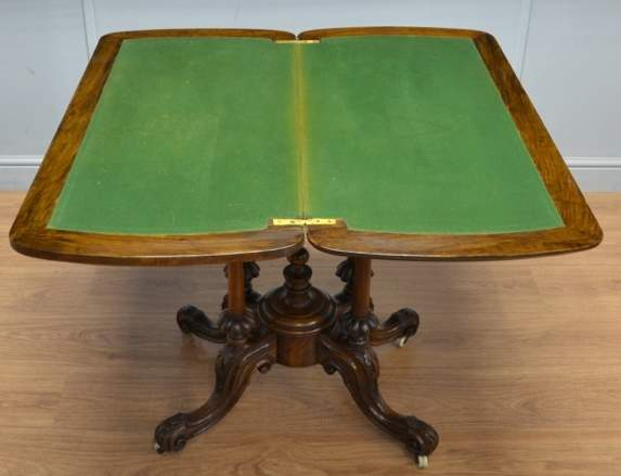 Card Table. English. C.1860. Burr Walnut. Height: 29.5 Inches (75 Cm.)  Width: 36 Inches (91) Depth: Closed 18 Inches (46 Cm); Opened 35.5 Inches  (90 Cm.).