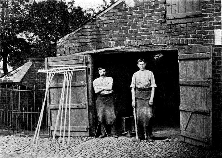nipper with navvies outside tommy cabin, 1890s