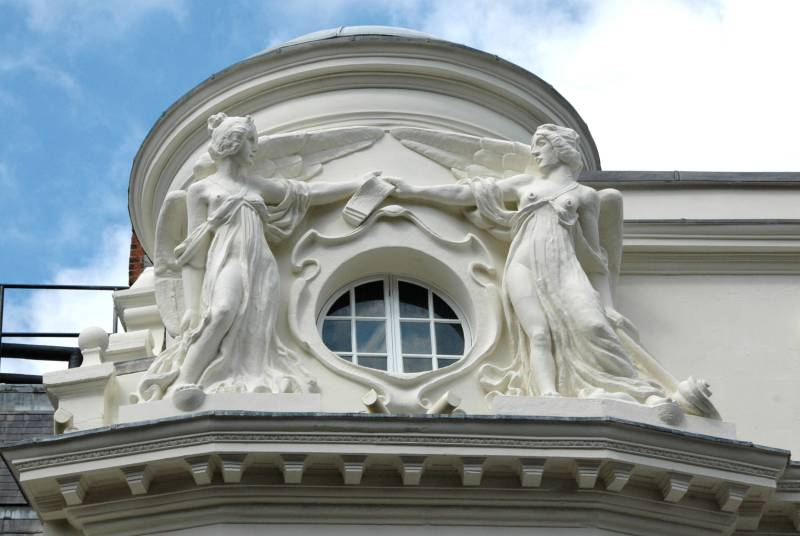 Two winged female figures apollo theatre london