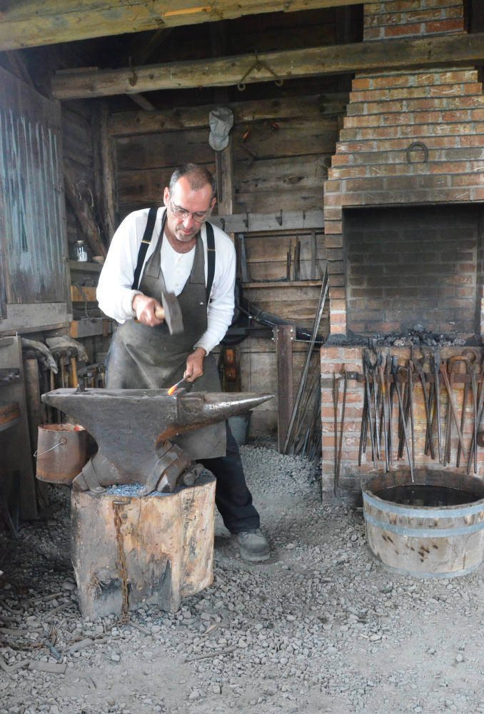 The Blacksmith At Work Making Nails By Hand